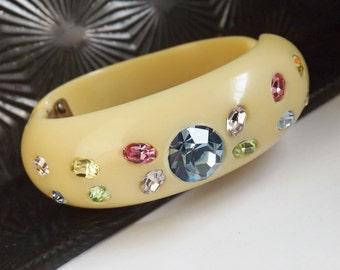 Vintage rhinestone hinged clamper bracelet cuff cream celluloid thermoplastic blue pastel multi color stones
