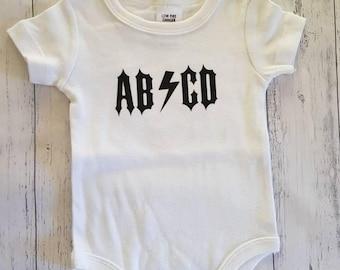 AB/CD onesie
