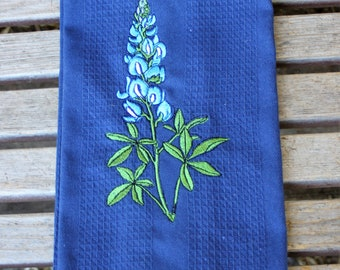 A blue flower embroidered on a 16x28 Cotton, Absorbent Waffle Weave blue dish towel, Kitchen Towel