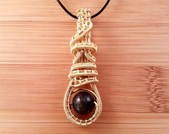 Gold wire wrapped black and gold golden obsidian stim fidget pendant necklace