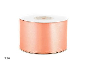 25 meters of 50 mm wide peach satin ribbon