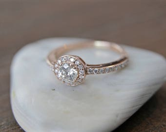 Diamond halo engagement ring in 14k rose gold .45ct
