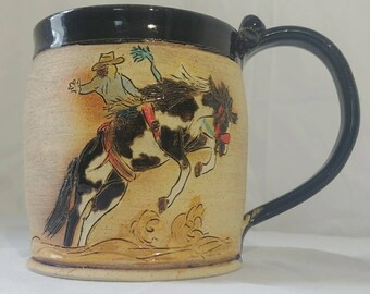 Cowboy and Bronc coffee or tea mug stoneware pottery
