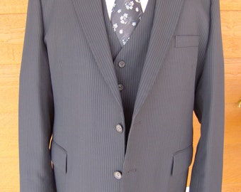 30% off Jon York Navy Pinstripe Wool Suit. Price includes professional dry cleaning.