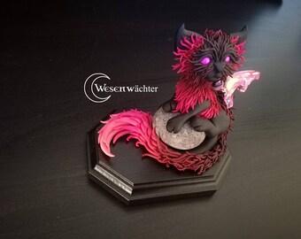 Handmade imaginative cat sculpture