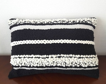 Black and white woven pillow
