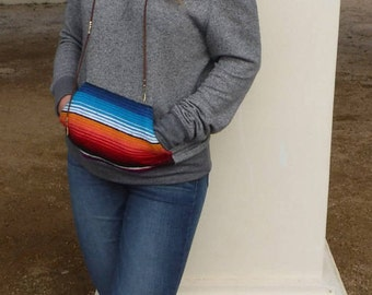 Off the shoulder sweater with serape pocket