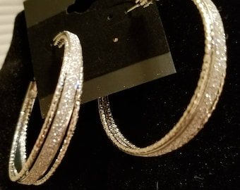 Golden shimmer hoop earrings.