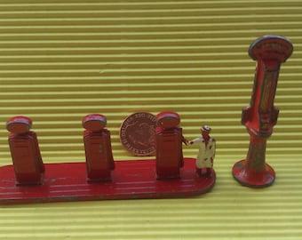 Vintage lead lesney and nestles gas station pump figures