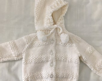 White hooded sweater, size 6 months