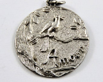 Bird on a Branch with Amour Underneath Sterling Silver Charm or Pendant.