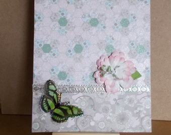 Green butterfly on sparkle card.