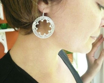 Silver hoop earrings with large antiqued silver filigree on sterling silver ear wires.