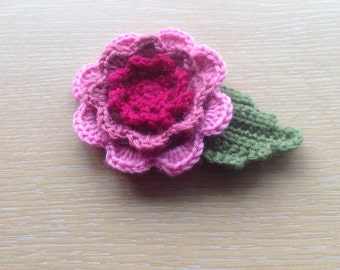 Hand crocheted Irish Rose brooch.