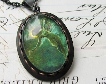 Absinthe Fairy necklace made with Fallen Angel Brass, handmade glass cabochon, black brass, green fairy pendant, fairy charm, magical wings