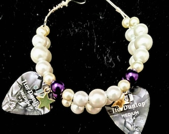 Small purple and white heart clasp guitar pick bracelet.