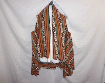 Serape (Sir-wrap-pay) a knee length, wrap-a-round, jacket, shawl, poncho, vest like, very soft outer garment, many colors. Wear it 5 ways!