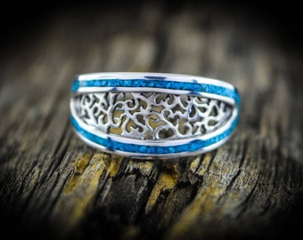 Sterling silver vine ladies ring with a border of inlaid Turquoise Sizes: 5.5, 6, or 6.5