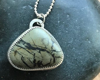 Beach pebble sterling silver pendant necklace.