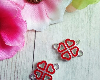 2 red clover in bright silver metal connectors