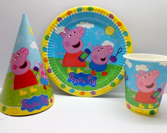 Peppa Pig paper tableware. Peppa Pig paper plates, cups and party hats. Set for children's party or birthday. Peppa Pig and  George party.