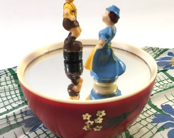 vintage midcentury music box with Bavarian German Deutsch spinning dancing couple in traditional folk costume on mirror w red plastic base