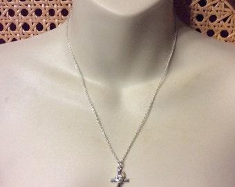 LA Rocks vintage silver toned metal cross rhinestone necklace.