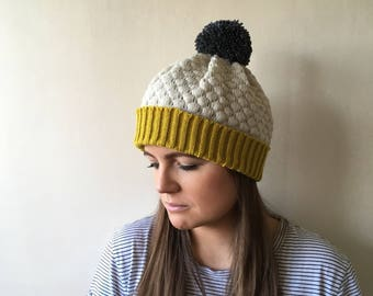 Knitted  lambswool bobble hat.