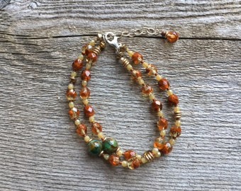Burnt orange and forest green double strand bracelet
