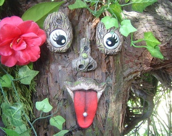 Tree Faces outdoor garden decorations, garden ornaments, sculptures, studded tongue, statues.  Great gifts for all gardeners, funny faces.