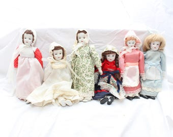 Six porcelain dolls,  one set of triplets