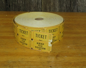 Partial roll of double raffle tickets in yellow