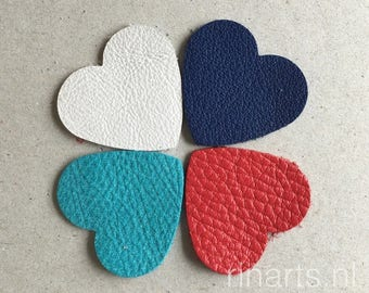 Leather hearts 3.5x3.5 cm  / 1.4 x 1.4 inch for your DIY projects. A set is 25 pieces, hearts in turquoise, red, white  and blue