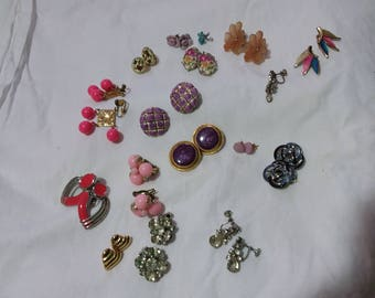 Large group of vintage earrings clip on screw back earrings and pierced.  Estate found costume jewelry.