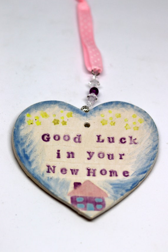 Good Luck in Your New Home Handmade Pottery Heart, a lovely house warming gift for a friend. Which will arrive in a white gossamer bag.