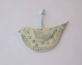 Ceramic bird to hang with prints of lace, flowers, turquoise blue enamel
