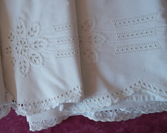 Very beautiful cloth with swags and rich embroidery