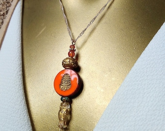Ethnic pendant, gold and orange glass OWL