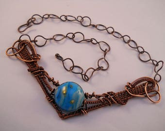 Blue lampwork bead with gold dots woven copper wire bib necklace