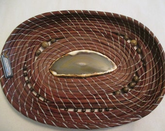 Handmade pine needle basket with agate center.