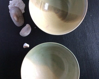 Yellow and green porcelain soup bowls