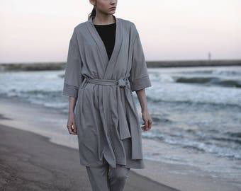 Grey leisure suit. Two-piece suit: trousers + cardigan.