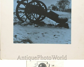 Cannon gun in winter field tinted vintage art photo