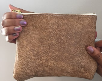 Sand colored leather clutch