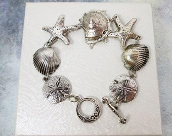 Silver Sea Charms Link Bracelet Mermaid Jewelry Nautical Sea Shell Bracelet Starfish Bracelet Sand Dollar Bracelet Beach Ocean Jewelry Gift