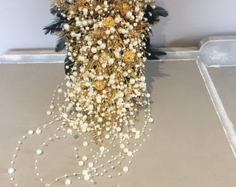 Cascade shower bridal bouquet in gold and ivory with black feathers and cascding pearls, brides bouquet, trailing bouquet, feather bouquet