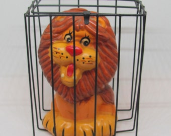 Ceramic Lion In a Cage Bank Kitsch Decor