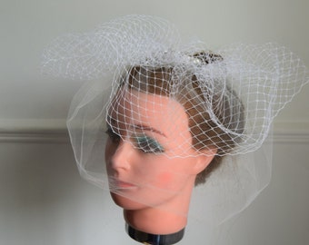 Blusher with a birdcage veil