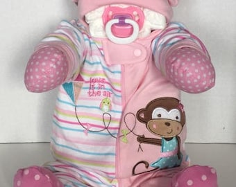 monkey diaper baby 3-6 girl sitting up life-like and super cute and unique baby shower gift or centerpiece