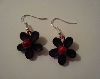 The pair of black and red flower earrings